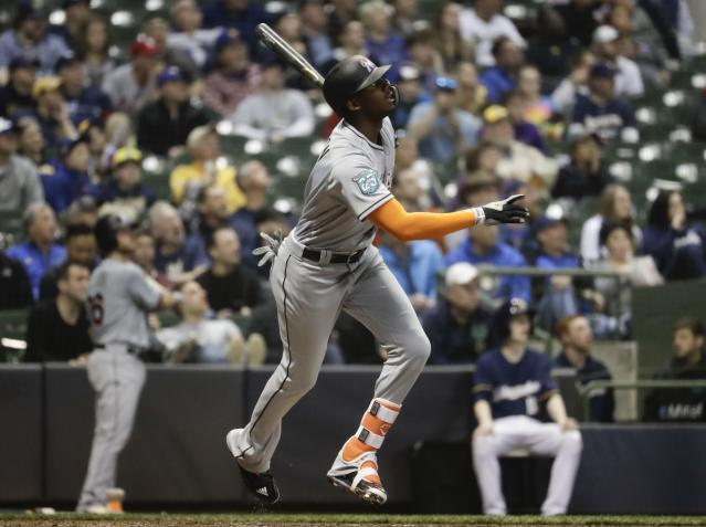 Miami Marlins' Lewis Brinson hits a two-run home run during the fifth inning of a baseball game against the Milwaukee Brewers Thursday, April 19, 2018, in Milwaukee. (AP Photo/Morry Gash)