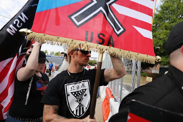 <p>Members and supporters of the National Socialist Movement, one of the largest neo-Nazi groups in the US, hold a rally on April 21, 2018 in Newnan, Ga. (Photo: Spencer Platt/Getty Images) </p>