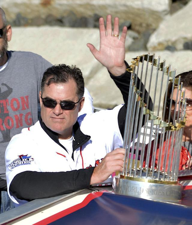 Boston Red Sox manager John Farrell waves beside a World Series trophy while riding in an amphibious duck boat on the Charles River during a victory parade celebrating the team's World Series title Saturday, Nov. 2, 2013, in Cambridge, Mass. (AP Photo/Josh Reynolds)