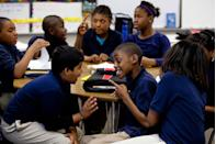 """<p>Fourth grade students at a school for the gifted attempt to solve a probability exercise with a little teamwork.</p><p><strong>RELATED: </strong><a href=""""https://www.goodhousekeeping.com/health/wellness/a23931342/flu-symptoms-kids-toddlers/"""" rel=""""nofollow noopener"""" target=""""_blank"""" data-ylk=""""slk:Flu Symptoms in Kids Come Suddenly, But You Can Act Fast If You Know What to Look For"""" class=""""link rapid-noclick-resp"""">Flu Symptoms in Kids Come Suddenly, But You Can Act Fast If You Know What to Look For</a></p>"""