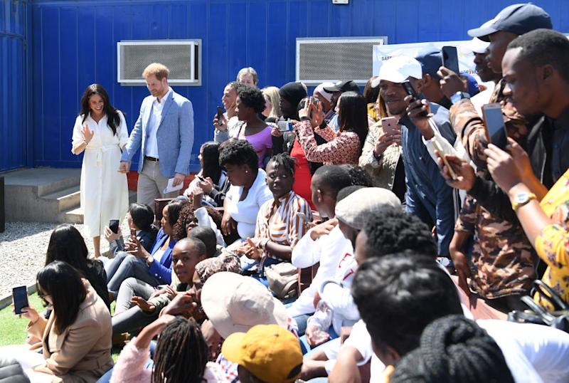 JOHANNESBURG, SOUTH AFRICA - OCTOBER 02: Prince Harry, Duke of Sussex and Meghan, Duchess of Sussex visit Tembisa township to learn about Youth Employment Services (YES) on October 2, 2019 in Johannesburg, South Africa. The Duke and Duchess of Sussex are on an official visit to South Africa. (Photo by Facundo Arrizabalaga - Pool/Getty Images)