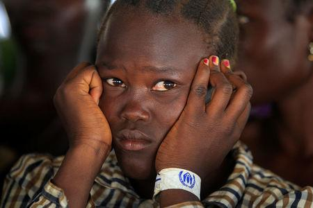 File Photo: A girl who fled fighting in South Sudan queues on arrival at Bidi Bidi refugee resettlement camp near the border with South Sudan, in Yumbe district, northern Uganda December 7, 2016. REUTERS/James Akena/File Photo