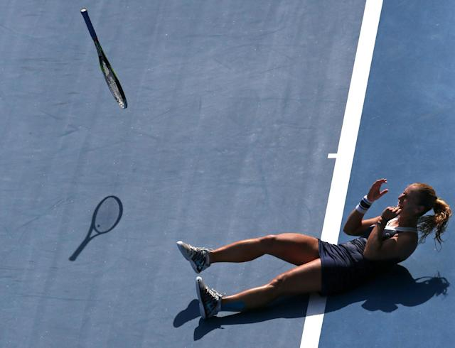 Dominika Cibulkova of Slovakia throws a racket as she celebrates after defeating Agnieszka Radwanska of Poland during their semifinal at the Australian Open tennis championship in Melbourne, Australia, Thursday, Jan. 23, 2014.(AP Photo/Eugene Hoshiko)
