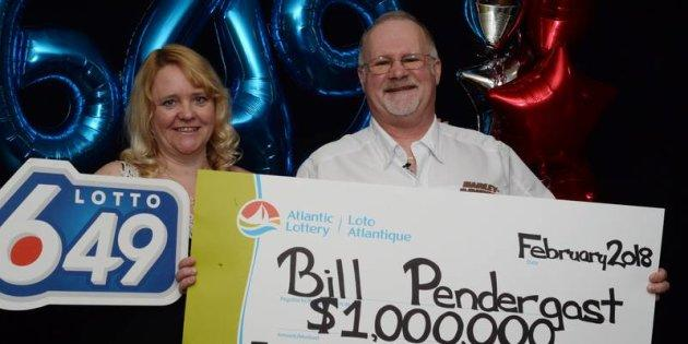 Carrie and Bill Pendergast pose with their novelty cheque after Bill won $1 million in a Lotto 6/49 draw.