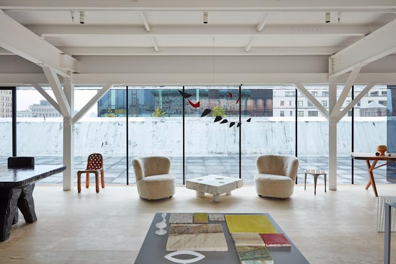 Flemming Lassen lounge chairs and a 1963 Alexander Calder mobile.