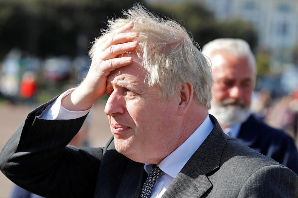 Britain's Prime Minister Boris Johnson gestures as he campaigns in Llandudno, north Wales on April 26, 2021, ahead of the May 6 Welsh elections. (Photo by PHIL NOBLE / POOL / AFP) (Photo by PHIL NOBLE/POOL/AFP via Getty Images)