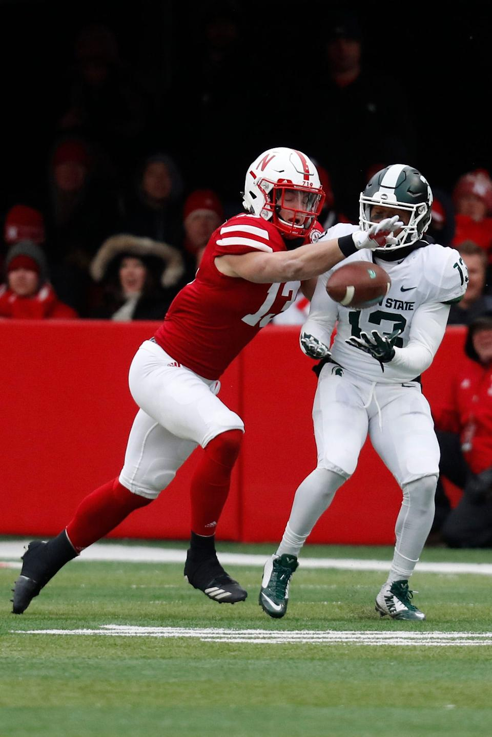 Nov 17, 2018; Lincoln, NE, USA; Michigan State Spartans wide receiver Mickey Macius (13) catches the pass against Nebraska Cornhuskers safety JoJo Domann (13) in the first half at Memorial Stadium. Mandatory Credit: Bruce Thorson-USA TODAY Sports