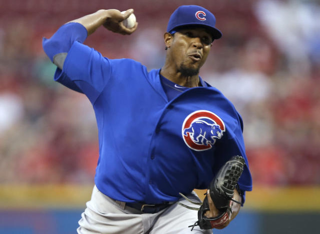 Chicago Cubs starting pitcher Edwin Jackson throws against the Cincinnati Reds in the first inning of a baseball game, Tuesday, Sept. 10, 2013, in Cincinnati. (AP Photo/Al Behrman)