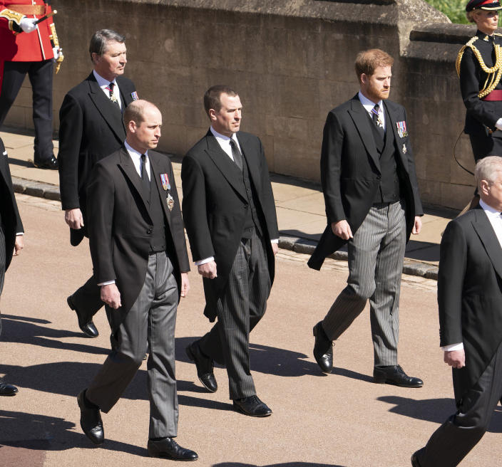Image: Prince William, Peter Phillips, Prince Harry, and Vice-Admiral Sir Timothy Laurence follow Prince Philip's coffin as it arrives at St. George's Chapel. (Paul Edwards / WPA Pool via Getty Images)