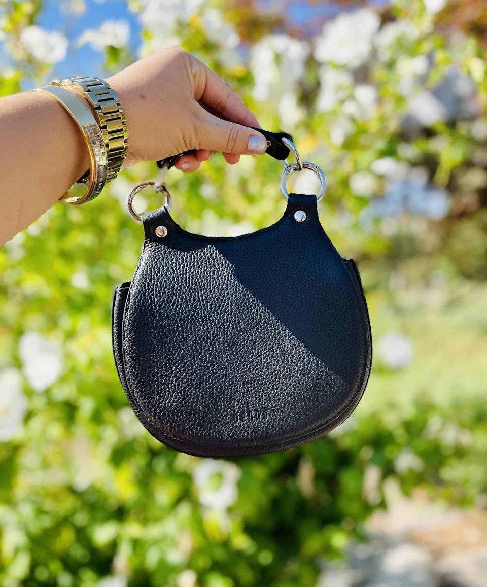 <p>Since using this <span>Tilda Mini Saddle Bag</span> ($450), I haven't changed it out once. It comes in tons more colors like cream, navy blue, and even lime green.</p>
