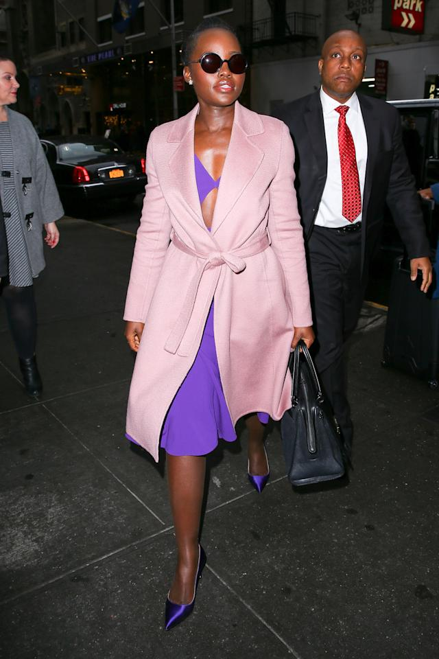 <p>Never afraid of mixing colours, Lupita Nyong'o brightened up the streets of New York in a grape-hued dress, matching shoes and a pastel pink overcoat. <i>(Photo by Felipe Ramales/Splash News)</i></p>