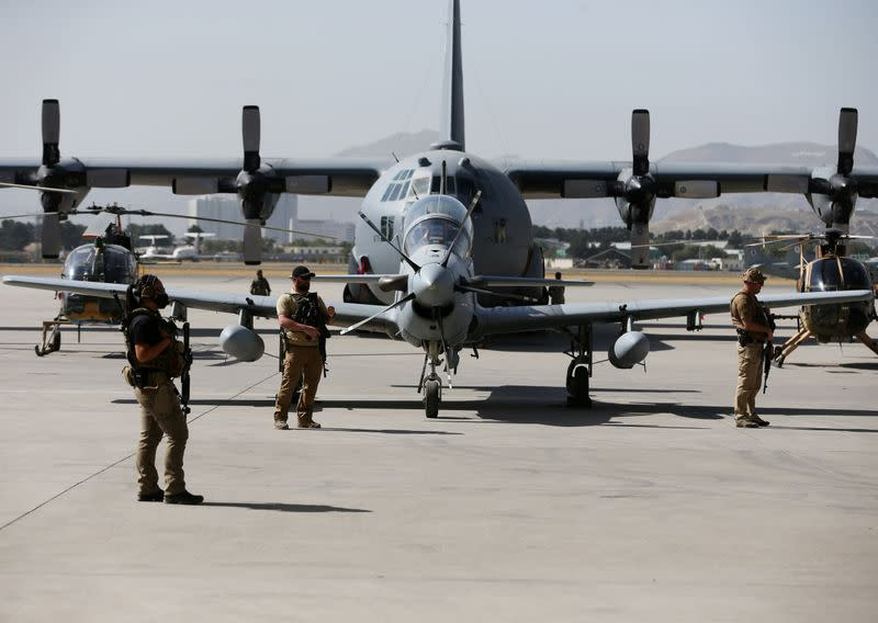 FILE PHOTO: U.S. security personnel stand guard during a handover ceremony of A-29 Super Tucano planes from U.S. to the Afghan forces, in Kabul, Afghanistan