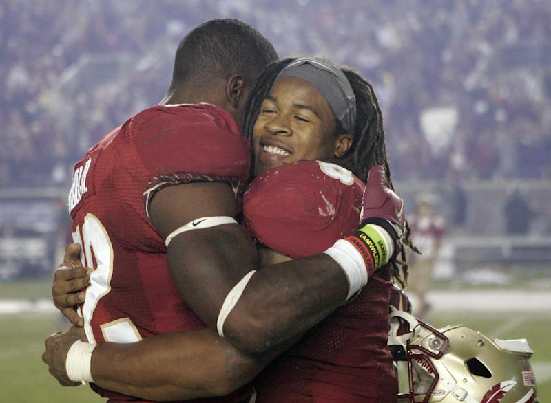 Florida State running back Devonta Freeman, right, hugs fellow unning back James Wilder Jr. after the team defeated Miami 41-14 in an NCAA college football game Saturday, Nov. 2, 2013, in Tallahassee, Fla. Freeman had three touchdowns in the win. (AP Photo/Steve Cannon)