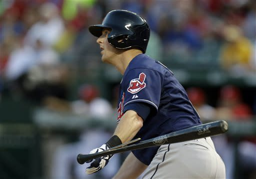 Cleveland Indians Drew Stubbs watches his broken bat two-run RBI single fly away during the fifth inning of a baseball game against the Texas Rangers on Tuesday, June 11, 2013, in Arlington, Texas. (AP Photo/LM Otero)