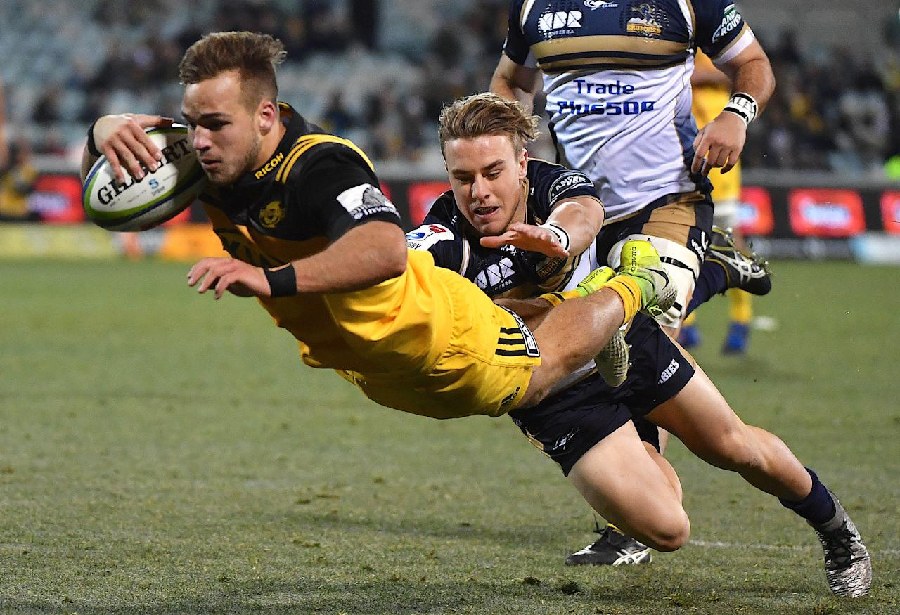 Rugby Union - Super Rugby - Wellington Hurricanes vs ACT Brumbies - Canberra, Australia - July 21, 2017 - Wes Goosen of the Wellington Hurricanes dives to score a try during the quarterfinal Super Rugby match.   AAP/Mick Tsikas/via REUTERS    ATTENTION EDITORS - THIS IMAGE WAS PROVIDED BY A THIRD PARTY. NO RESALES. NO ARCHIVE. AUSTRALIA OUT. NEW ZEALAND OUT.