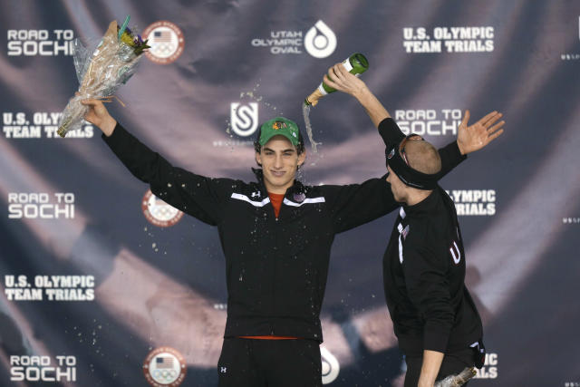 Winner Emery Lehman, left, celebrates with third-place finisher Patrick Meek, right, on the podium following the men's 10,000 meters during the U.S. Olympic speedskating trials Wednesday, Jan. 1, 2014, in Kearns, Utah. (AP Photo/Rick Bowmer)