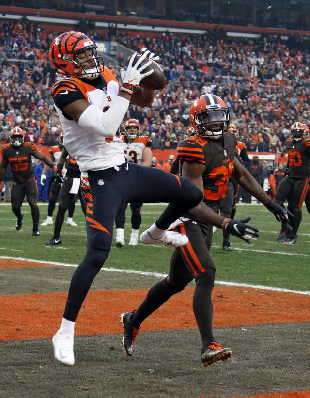 Cincinnati Bengals wide receiver Cody Core (16) catches a pass for a two-point conversion as Cleveland Browns defensive back T.J. Carrie (38) watches during the second half of an NFL football game, Sunday, Dec. 23, 2018, in Cleveland. The Browns won 26-18. (AP Photo/Ron Schwane)