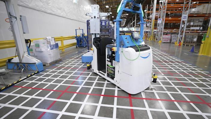 Robotic transports developed by Amazon for use in its fulfillment centers. / Credit: CBS News