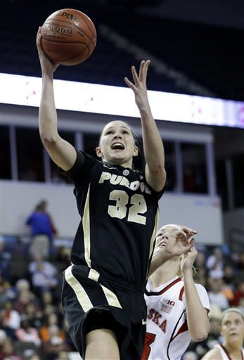 Purdue forward Sam Ostarello (32) drives to the basket past Nebraska forward Emily Cady (23) during the first half of an NCAA college basketball game in the Big Ten women's tournament in Hoffman Estates, Ill., on Saturday, March 9, 2013. (AP Photo/Nam Y. Huh)