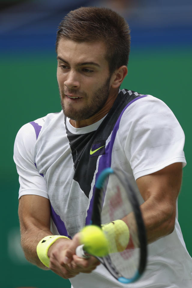Borna Coric of Croatia hits a return shot against Andrey Rublev, of Russia during their men's singles match at the Shanghai Masters tennis tournament at Qizhong Forest Sports City Tennis Center in Shanghai, China Tuesday, Oct. 8, 2019. (AP Photo/Andy Wong)