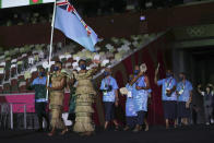 Rusila Nagasau and Jerry Tuwai, of Fiji, carry their country's flag during the opening ceremony in the Olympic Stadium at the 2020 Summer Olympics, Friday, July 23, 2021, in Tokyo, Japan. (Hannah McKay/Pool Photo via AP)