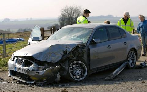 B0B8F5 BMW car after a crash Oxfordshire England United Kingdom - Credit: Alamy/Tim Graham