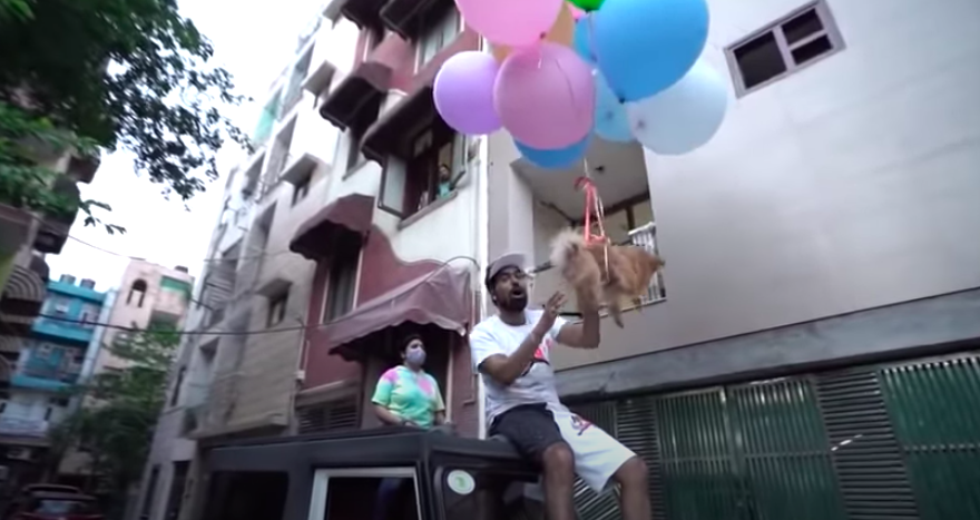 <p>A Delhi-based YouTuber has been arrested for tying his pet dog to hydrogen balloons and making it float up in the air</p> (India Today/YouTube/Screengrab )