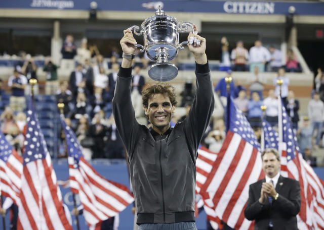 Rafael Nadal, of Spain, holds up the championship trophy after winning the men's singles final over Novak Djokovic, of Serbia, at the 2013 U.S. Open tennis tournament, Monday, Sept. 9, 2013, in New York. (AP Photo/Darron Cummings)
