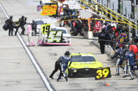 Ryan Sieg (39) makes a pit stop with others during a NASCAR Xfinity Series auto race Saturday, July 10, 2021, in Hampton, Ga. (AP Photo/John Amis)