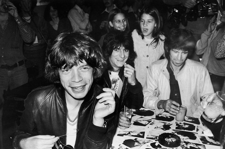<p>The Rolling Stones sign autographs for fans at a release party at the Trax nightclub for the band's <em>Love You Live</em> album, September 23, 1977 in NYC.</p>