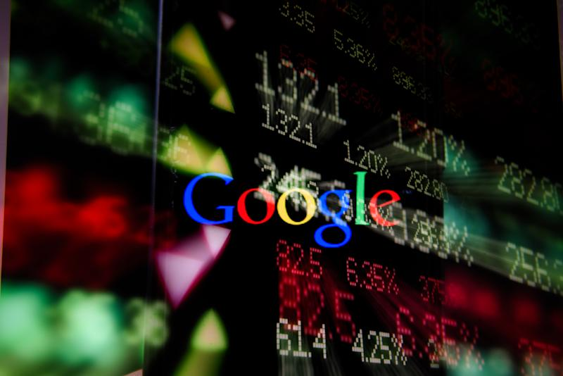 POLAND - 2020/07/16: In this photo illustration a multiple exposure image shows a Google logo displayed on a smartphone with stock market percentages on the background. (Photo Illustration by Omar Marques/SOPA Images/LightRocket via Getty Images)