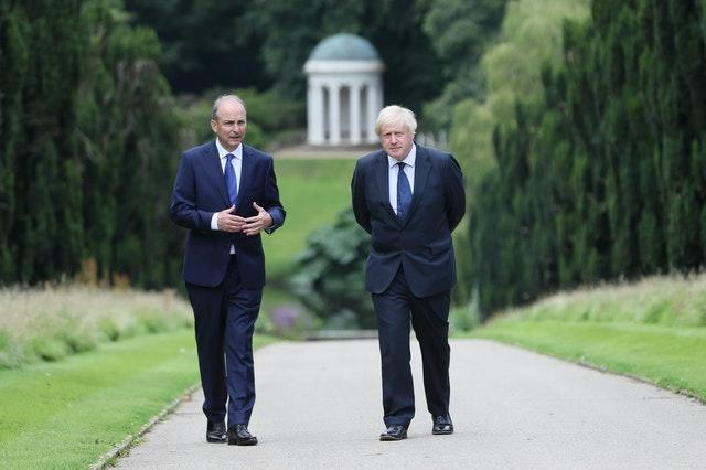 Prime Minister Boris Johnson (right) and Taoiseach Micheal Martin walking in the gardens of Hillsborough Castle (Brian Lawless/PA)