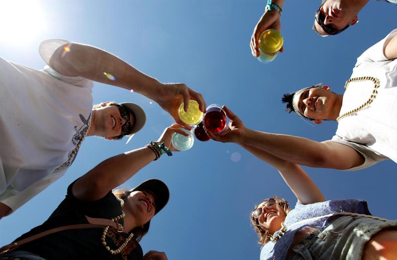 Volunteers and friends cheers their drinks at a past Brewers' Festival at Civic Center Park.