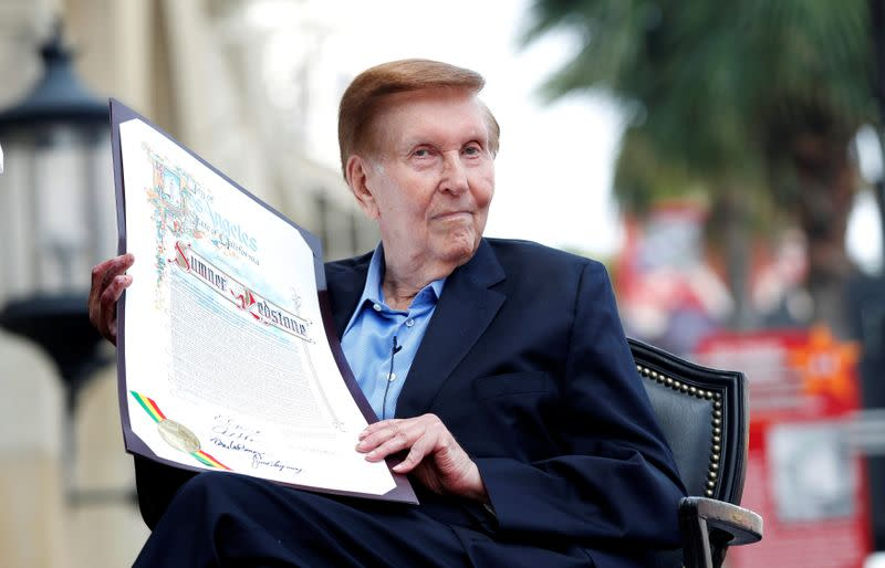 FILE PHOTO: Executive Chairman of Viacom and CBS Corporation Redstone holds a proclamation to his name in Hollywood