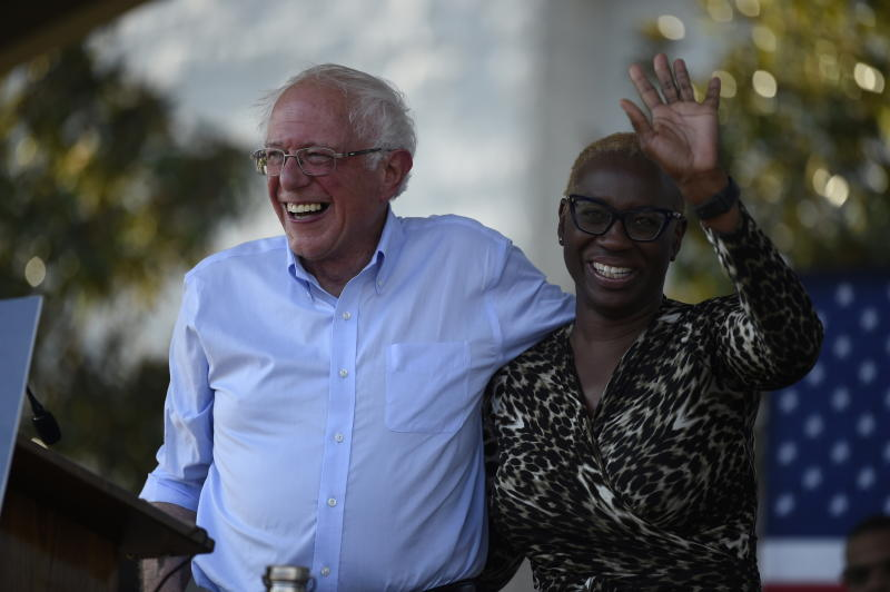 Democratic presidential contender Bernie Sanders smiles with Nina Turner, right, the national co-chair of his presidential campaign, at a Medicare for All town hall gathering on Friday, Aug. 30, 2019, in Florence, S.C. (AP Photo/Meg Kinnard)