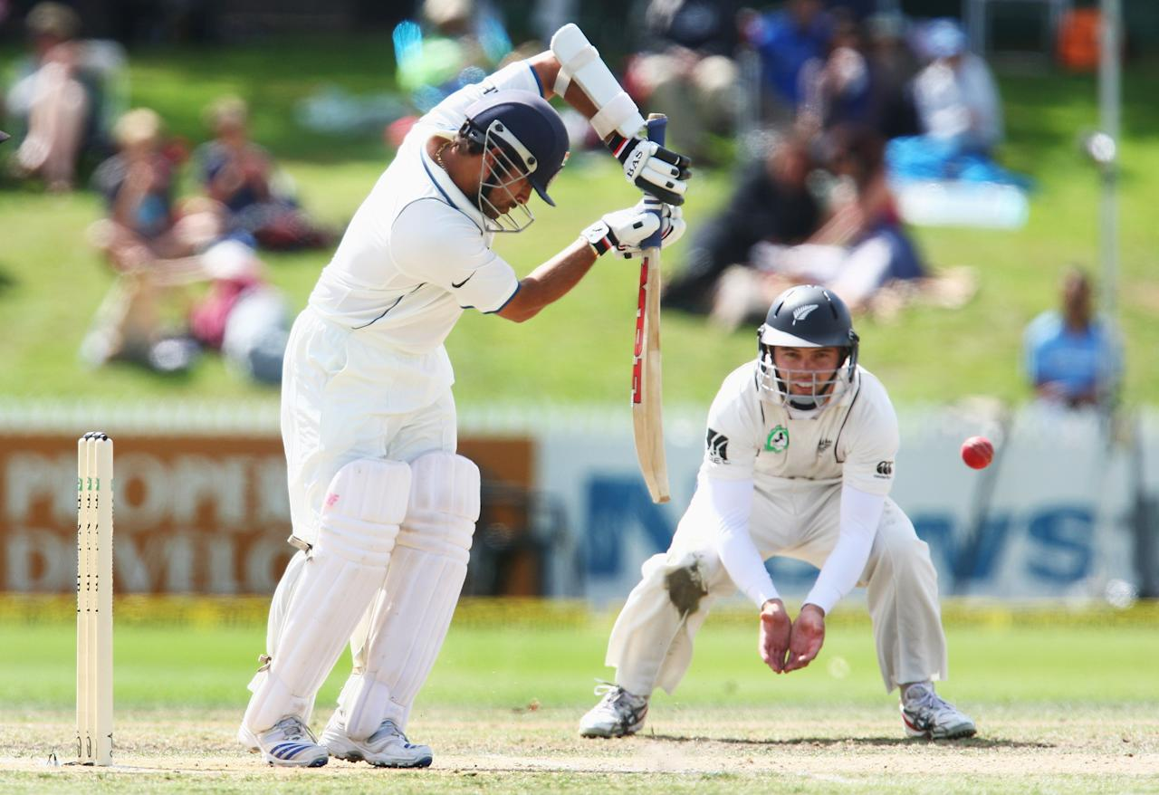 HAMILTON, NEW ZEALAND - MARCH 20:  Daniel Flynn of New Zealand looks on as Sachin Tendulkar of India blocks the ball during day three of the First Test match between New Zealand and India at Seddon Park on March 20, 2009 in Hamilton, New Zealand.  (Photo by Sandra Mu/Getty Images)