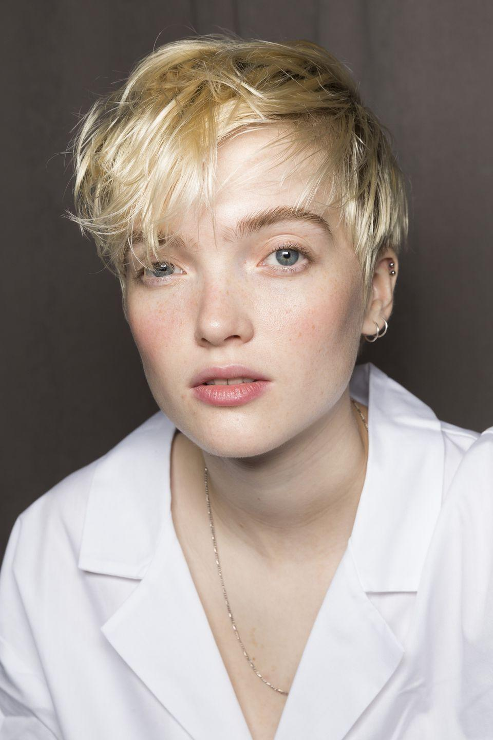 <p>Makeup artist Dick Page made it all about a flush of cream blush backstage at the Michael Kors show.</p>