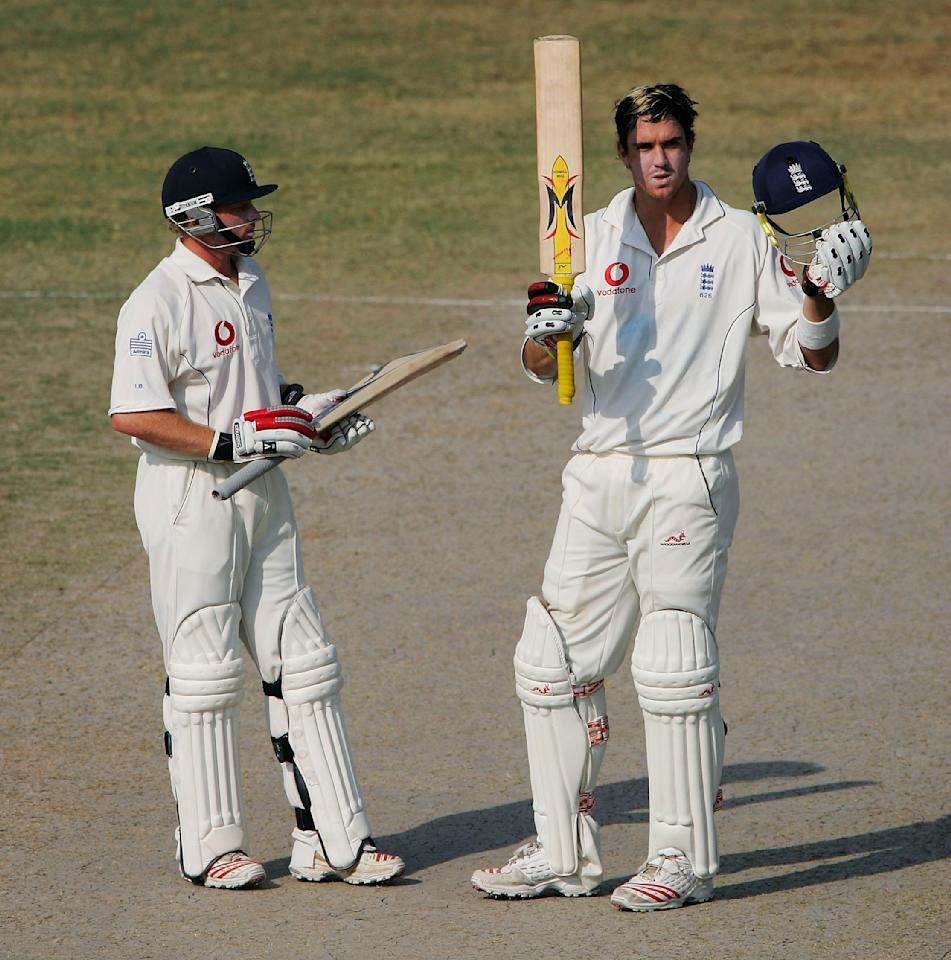 FAISALABAD, PAKISTAN - NOVEMBER 22:  England batsman Kevin Pietersen (R), beside Ian Bell, celebrates his century during The Third  Day of the Second Test Match between Pakistan and England at Iqbal Faisalabad Cricket Stadium on November 22, 2005 in Faisalabad, Pakistan. (Photo by Stu Forster/Getty Images)