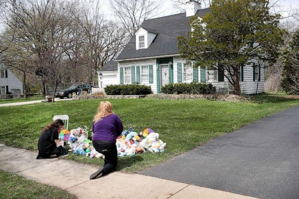 PHOTO: People pray next to a small memorial that sits outside the home of five-year-old Andrew 'A.J.' Freund on April 24, 2019, in Crystal Lake, Ill. (Scott Olson/Getty Images)