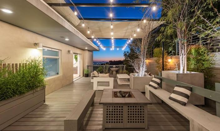 The two-story home features decks, balconies and patios that overlook the city below.