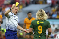 Referee Matthew Carley shows a yellow card to South Africa's Faf de Klerk during the Rugby Championship test match between the Springboks and the Wallabies in Brisbane, Australia, Saturday, Sept. 18, 2021. (AP Photo/Tertius Pickard)