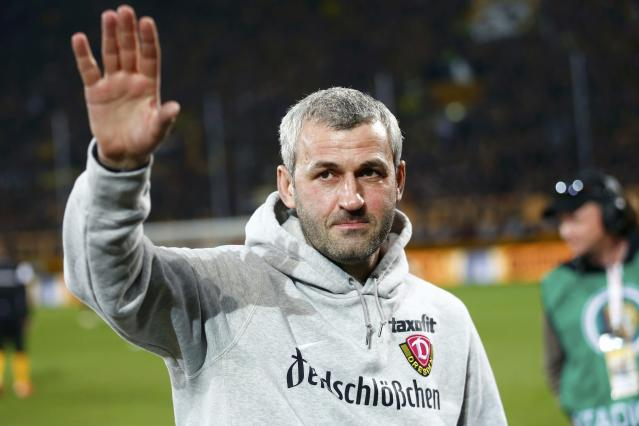 Dynamo Dresden's coach Peter Nemeth waves to supporters before his team's German Cup (DFB Pokal) soccer match against Borussia Dortmund in Dresden March 3, 2015. REUTERS/Hannibal Hanschke (GERMANY - Tags: SOCCER SPORT) DFB RULES PROHIBIT USE IN MMS SERVICES VIA HANDHELD DEVICES UNTIL TWO HOURS AFTER A MATCH AND ANY USAGE ON INTERNET OR ONLINE MEDIA SIMULATING VIDEO FOOTAGE DURING THE MATCH.