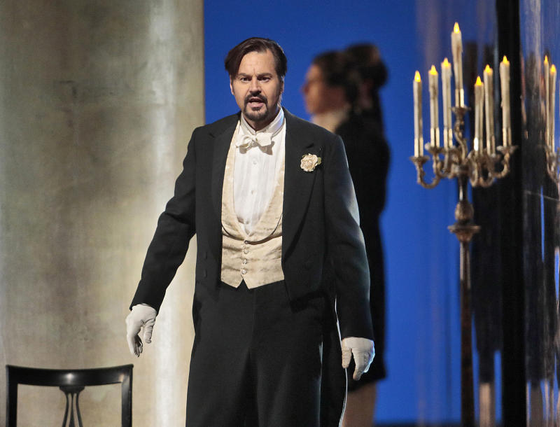 "This April 12, 2017 photo released by the Metropolitan Opera shows Peter Mattei portraying the title character in ""Eugene Onegin,"" in New York.  The Met's production, created by Deborah Warner, will be broadcast live in HD to movie theaters worldwide on Saturday. (Ken Howard/Metropolitan Opera via AP)"