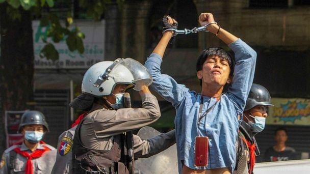 PHOTO: A pro-democracy protester is detained by riot police officers during a rally against the military coup in Yangon, Myanmar, Feb. 27, 2021.  (Stringer/Reuters)