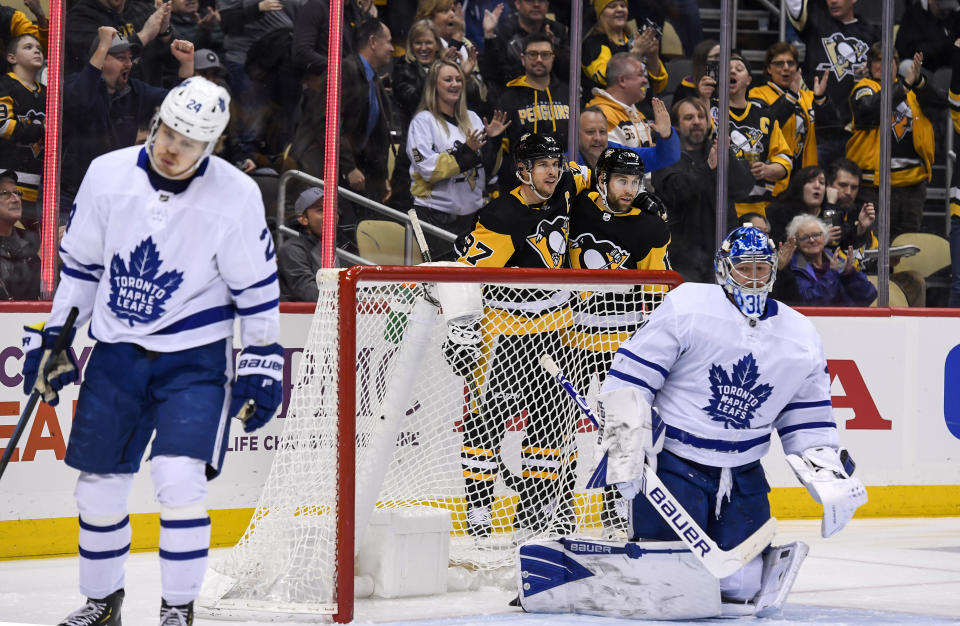 PITTSBURGH, PA - FEBRUARY 18: Pittsburgh Penguins Left Wing Jason Zucker (16) celebrates with Pittsburgh Penguins Center Sidney Crosby (87) after Zucker scored a goal past Toronto Maple Leafs Goalie Frederik Andersen (31) during the second period in the NHL game between the Pittsburgh Penguins and the Toronto Maple Leafs on February 18, 2020, at PPG Paints Arena in Pittsburgh, PA. (Photo by Jeanine Leech/Icon Sportswire via Getty Images)