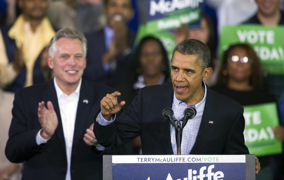 FILE - In this Nov. 3, 2013, file photo, President Barack Obama, right, as he speaks at a campaign rally with supporters for Virginia Democratic gubernatorial candidate Terry McAuliffe, left, at Washington Lee High School in Arlington, Va. Former President Obama will campaign with McAuliffe in the final stretch of the Virginia governor's race. McAuliffe's campaign announced that Obama will join him in Richmond on Oct. 23, 2021, to mobilize Virginians during early voting, which began weeks ago. AP Photo/Cliff Owen, File)