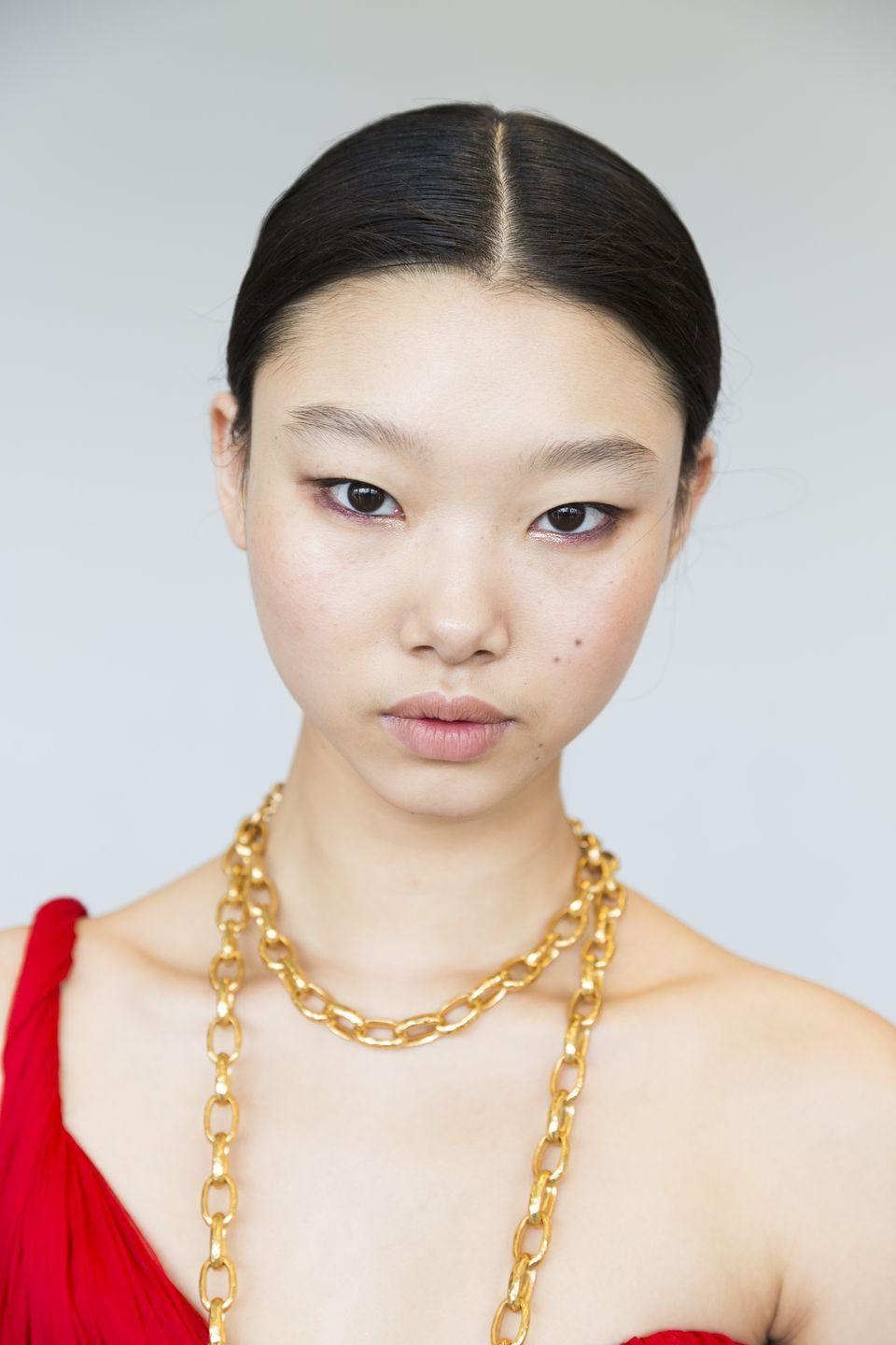 <p>Models walked the Oscar de la Renta runway wearing MAC Cosmetics Dazzleliner in Holiday Time, which doesn't even hit stores until next month. Makeup artists applied it precisely on the inner corner of the eye to add a touch of sparkle to the brown smoky eye.</p>