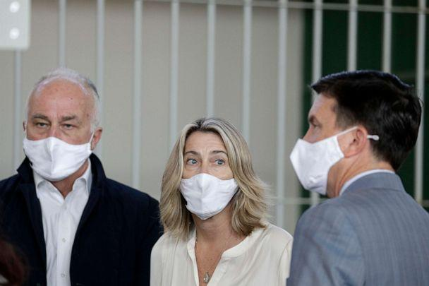 PHOTO: Ethan Elder, left, his wife Leah Lynn Elder, center, and their family attorney Craig Peters, right, are seen in court during the murder trial of their son Finnegan Lee Elder and his co-defendant Gabriel Natale-Hjorth in Rome, Italy, on May 5, 2021. (Gregorio Borgia/AP)