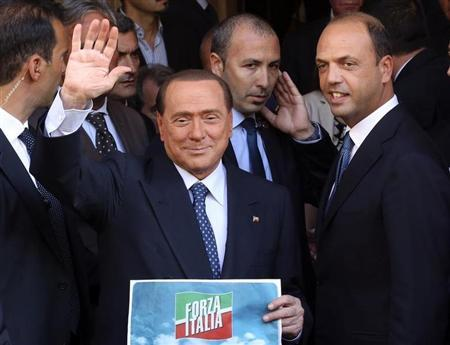 Silvio Berlusconi waves to supporters next to PDL Secretary Angelino Alfano in downtown Rome
