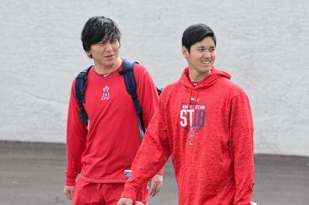 Feb 13, 2018; Tempe, AZ, USA; Los Angeles Angels pitcher Shohei Ohtani (right) looks on during a workout at Tempe Diablo Stadium. Mandatory Credit: Matt Kartozian-USA TODAY Sports